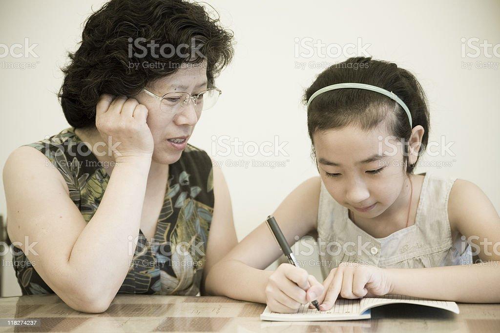 Studing with grandma royalty-free stock photo