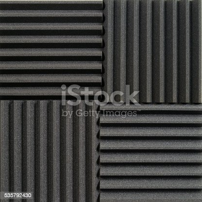 Background photo of recording studio sound dampening acoustical foam or tiles.