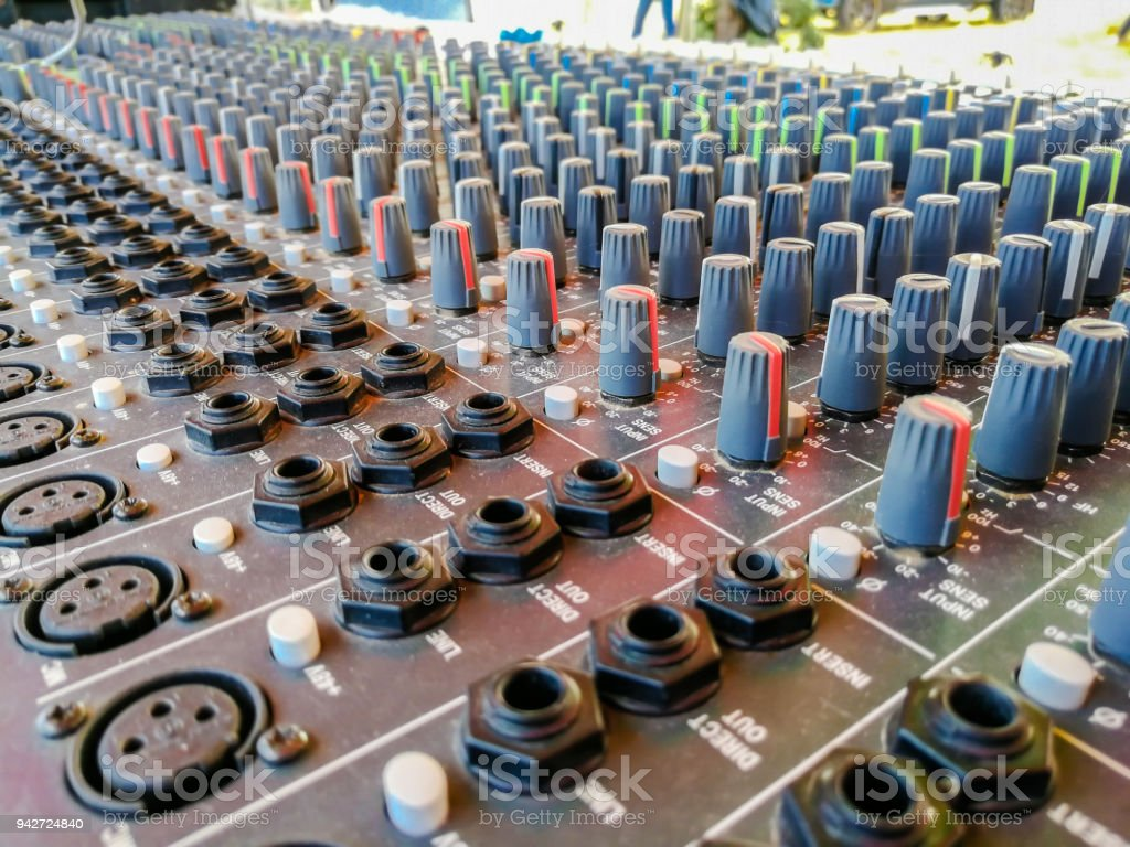 Close up of music mixer equalizer console for mixer control sound...