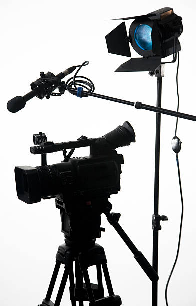 Studio camera gear on white 2 stock photo