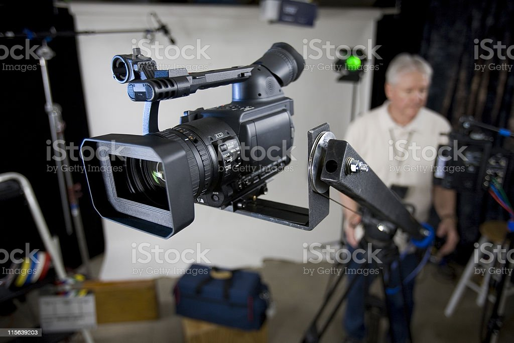 Studio camera on jib arm with operator royalty-free stock photo