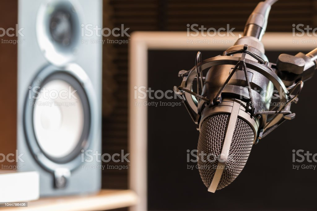 studio condenser microphone and loudspeakers monitor. recording...