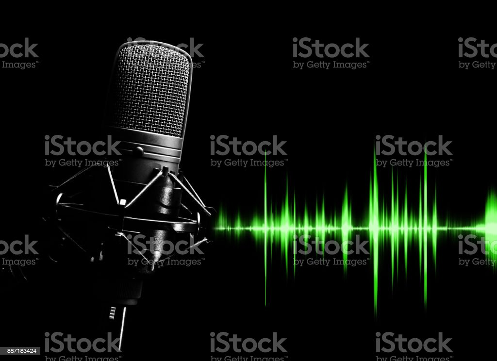studio condenser microphone & green waveform for sound recording concept stock photo