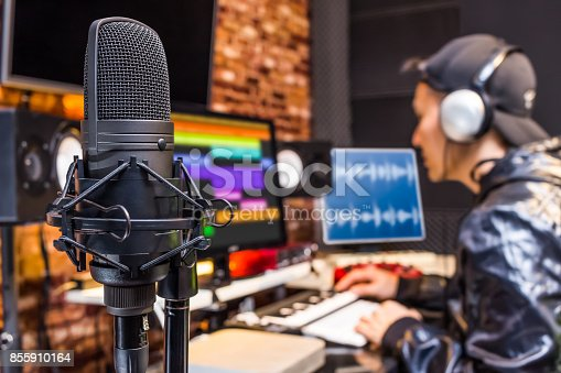 istock studio condenser microphone on sound engineer working in control room background. recording, broadcasting concept 855910164