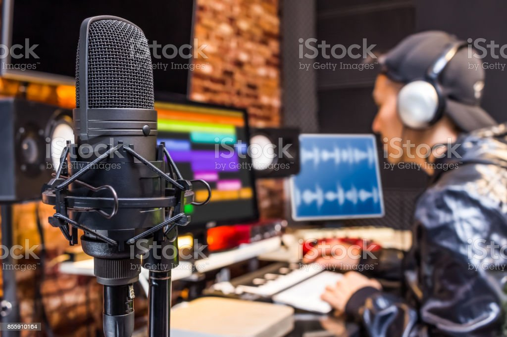studio condenser microphone on sound engineer working in control room background. recording, broadcasting concept stock photo