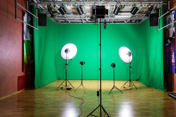 Studio for movies. Green screen. The chroma key. Lighting equipment in the pavilion. Show business stock photo