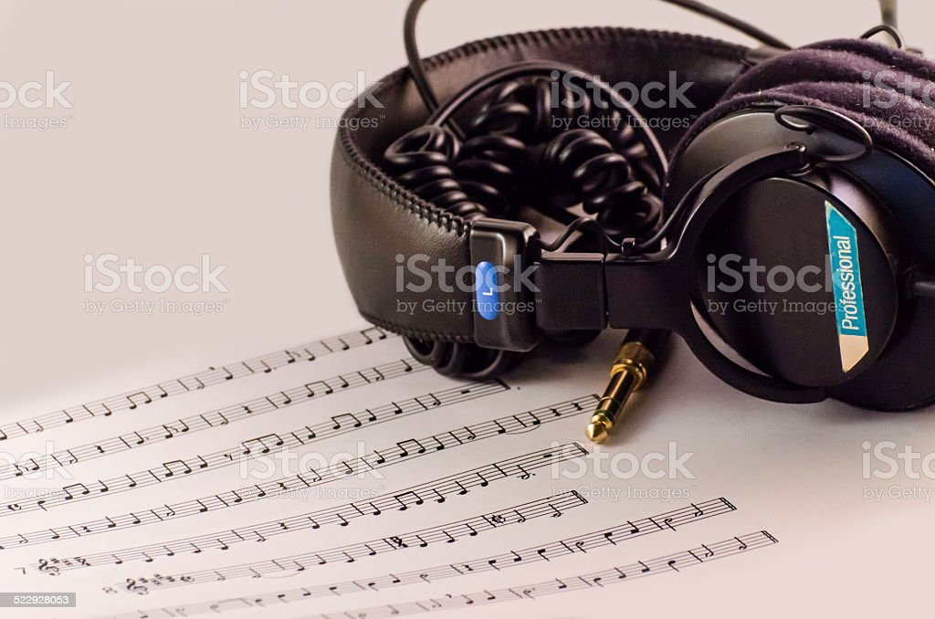 Studio Headphones and Music Sheet stock photo