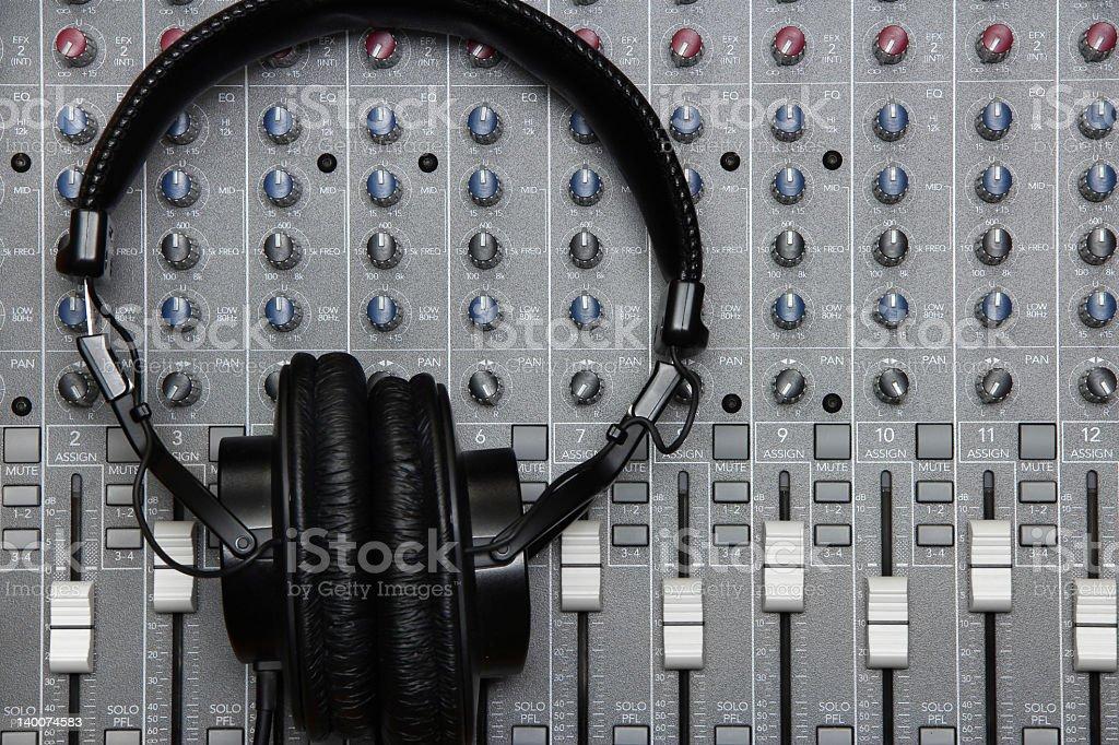 Studio Headphones on a Mixing Board stock photo