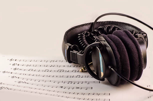 Studio Headphones over Music Sheet stock photo