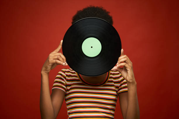 Studio headshot holding a vinyl record Studio headshot haitian ethnicity stock pictures, royalty-free photos & images