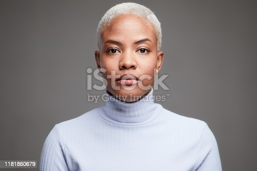 Lifestyle coffee shop made in Barcelona. Studio headshot of a Hispanic woman wearing a turtle neck pullover.