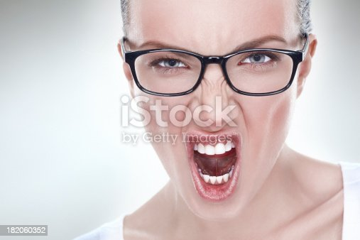 1138361116 istock photo Studio headshot of a young angry flushed woman screaming 182060352