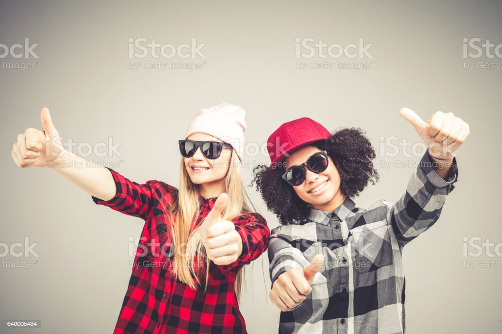 Studio lifestyle portrait of two best friends hipster girls going stock photo