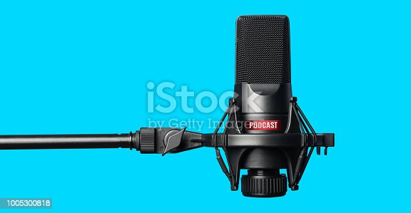 Studio microphone for recording podcasts over blue background