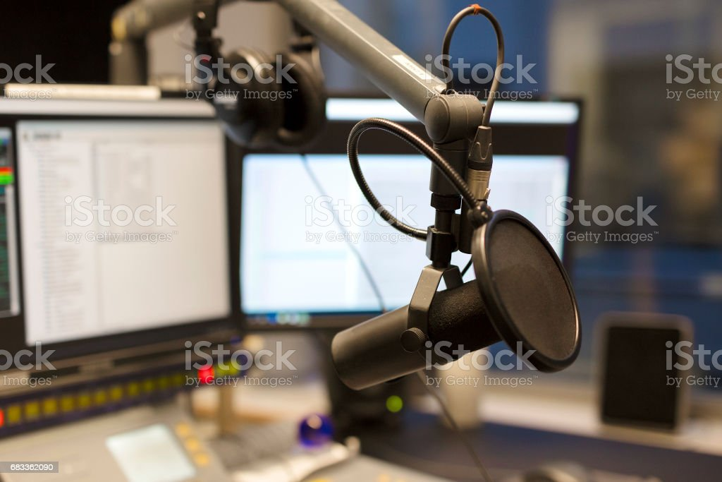 Studio microphone in front of radio station broadcasting equipment stock photo