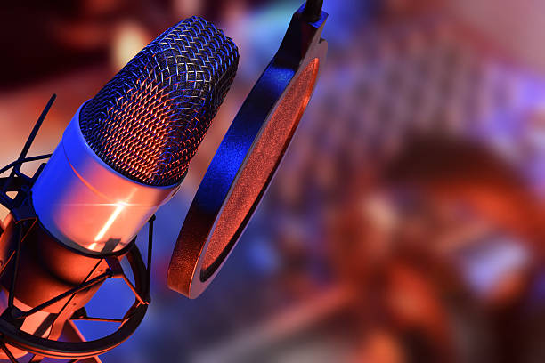 studio microphone with headphones live production - radio dj stock photos and pictures