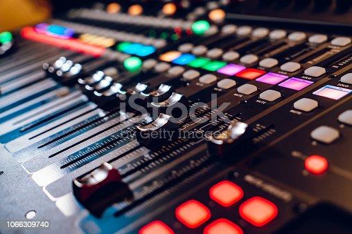 Studio mixing panel.Sound Mixer, Audio Mixer Slide. Music equipment blurred background.