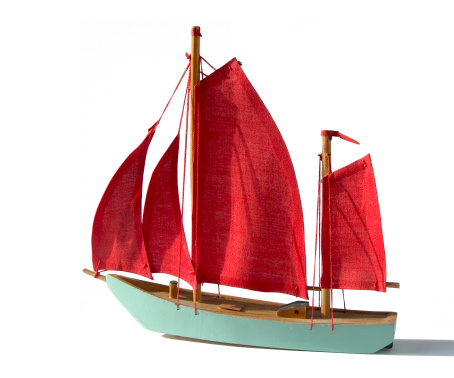 Studio Objects; Turquoise model sailing ship with red sails