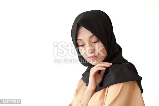 istock Studio photo of a beautiful young woman eastern type full-length, on a light background, dressed in the Muslim style 803707942