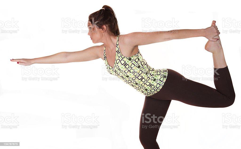 Studio photo of a woman practising yoga royalty-free stock photo