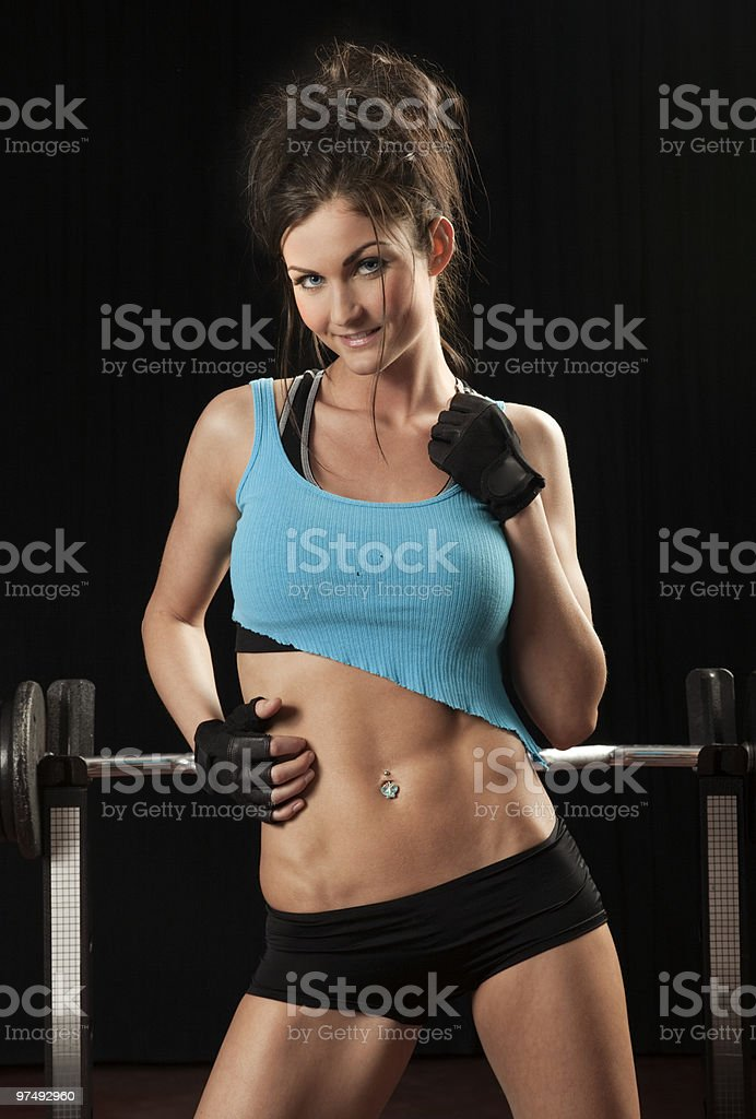 Studio photo of attractive female fitness model. Black background. royalty-free stock photo