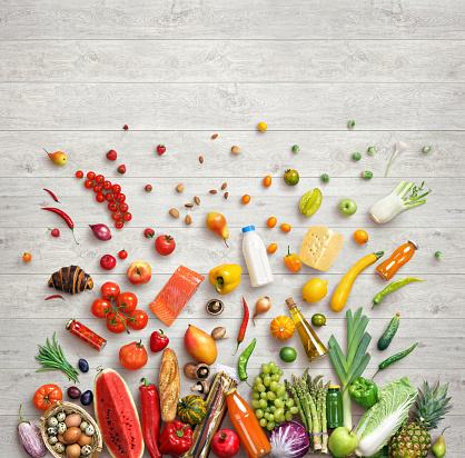 Healthy food background. Studio photo of different fruits and vegetables on wooden table. High resolution product, top view.