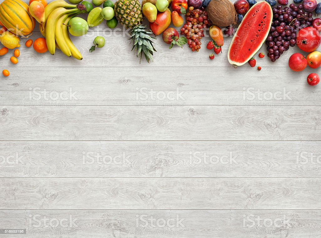 Studio photo of different fruits on white wooden table. stock photo
