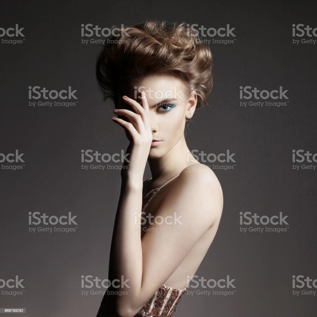 Studio photo of elegant lady with color smoky eyes makeup. stock photo