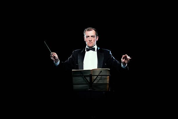 Studio Foto von Musik Dirigent holding seine baton – Foto