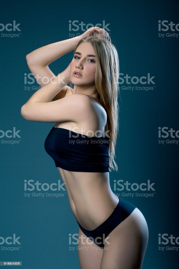 89c57d16e02 Studio photo of sexy woman in black lingerie against dark background - Stock  image .