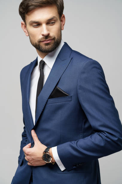 studio photo of young handsome businessman wearing suit stock photo