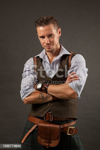 studio portrait of an attractive 30 year old man on a black background