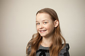 istock studio portrait of a 9 year old girl on a beige background 1215502084