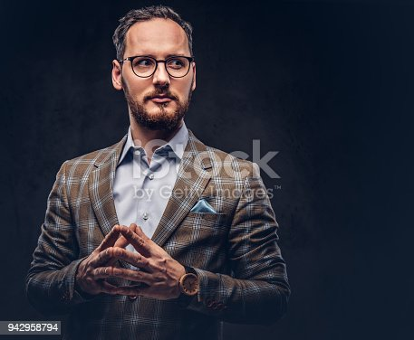 istock Studio portrait of a bearded hipster in glasses wearing a casual 942958794