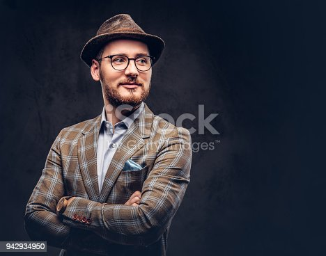 istock Studio portrait of a bearded hipster in hat and glasses wearing 942934950