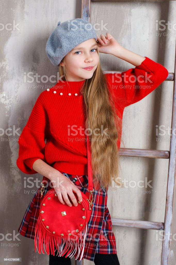 a077948f767 Studio Portrait Of A Little Girl In A Birette And A Red Sweater On A ...