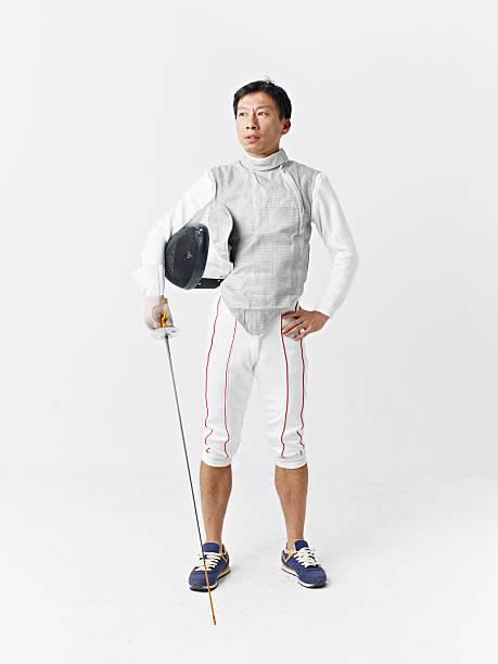studio portrait of a male asian fencer stock photo