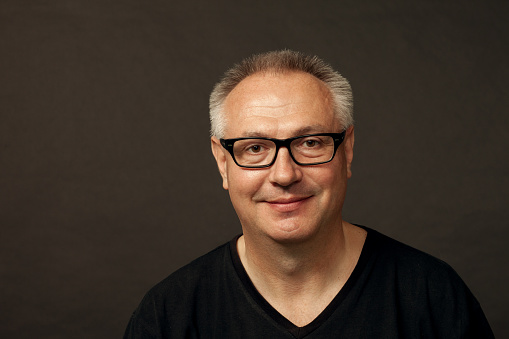 825083248 istock photo studio portrait of a mature man in glasses on a black background 1020771590