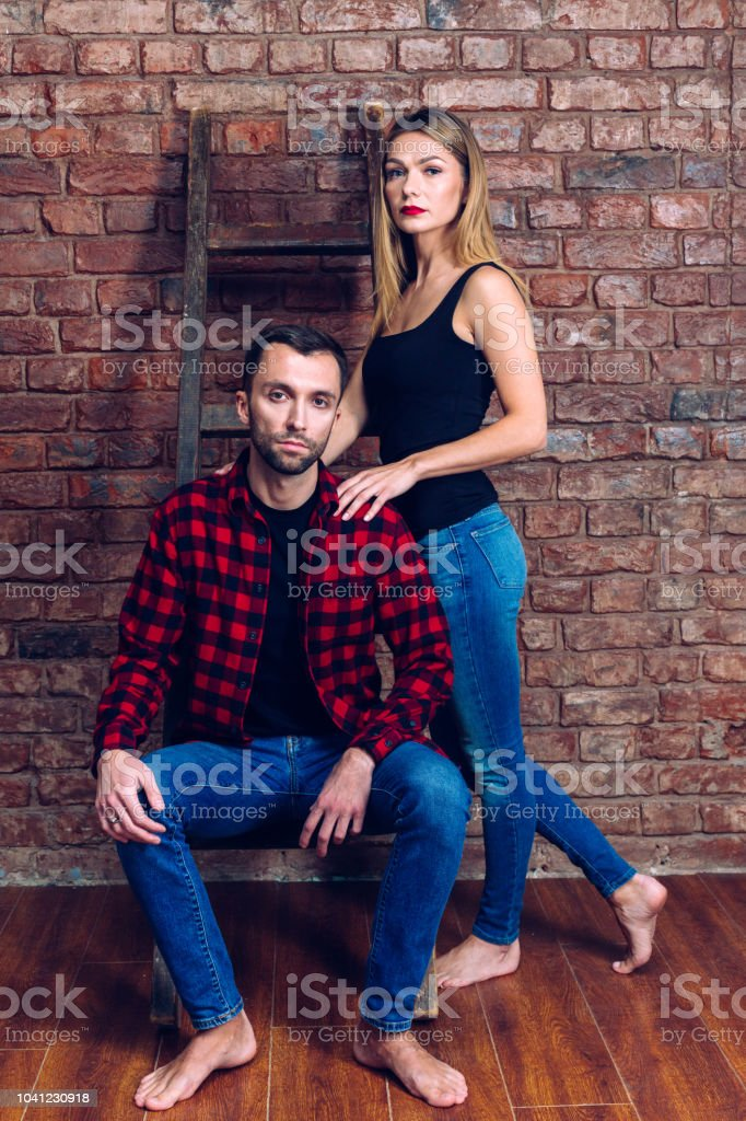 Studio portrait of a pretty woman and handsome man stock photo