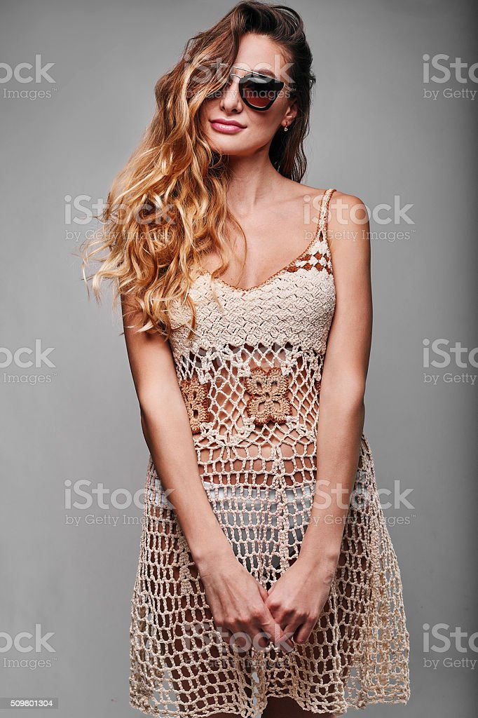 Studio portrait of a sexy blonde in gray knitted dress stock photo