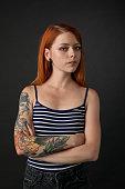 studio portrait of a tattoo artist on a black background