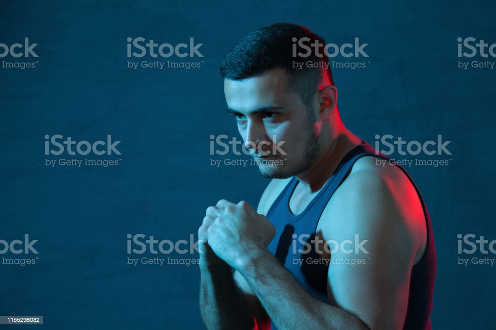 Studio portrait of a young fighting man