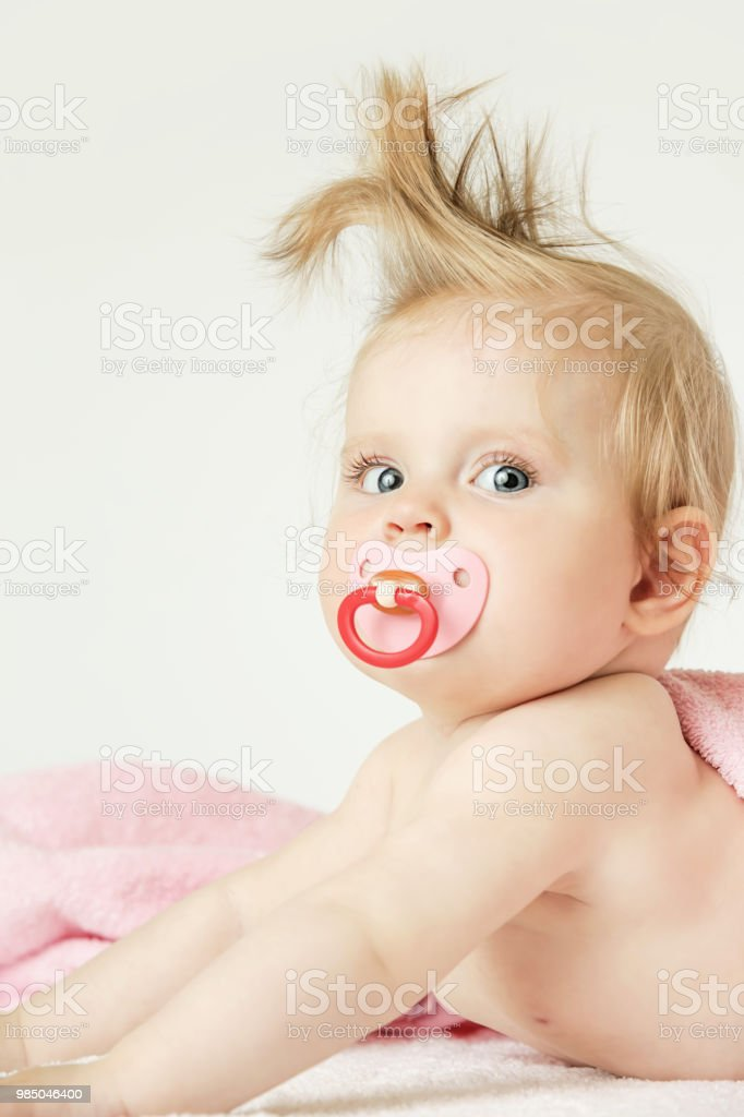 Studio Portrait Of Adorable 6 Months Old Baby With Funny Hairstyle