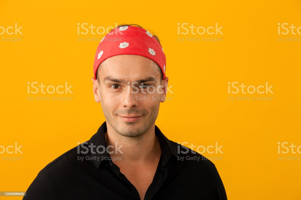 studio portrait of an attractive 30 year old man on a yellow background stock photo
