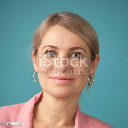 626257092 istock photo Studio portrait of an attractive 50 year old woman 1187458900