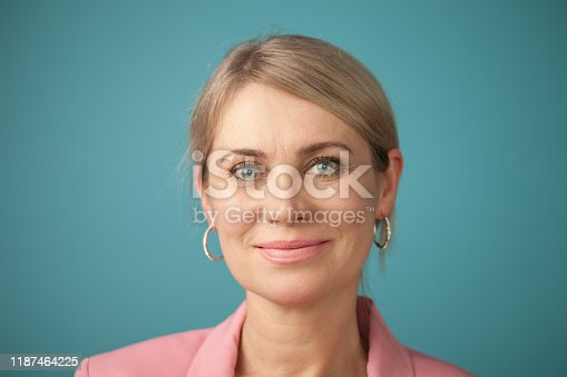 626257092 istock photo Studio portrait of an attractive 50 year old woman 1187464225
