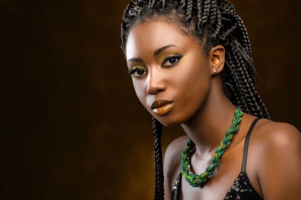 Studio portrait of attractive african woman with braids. stock photo