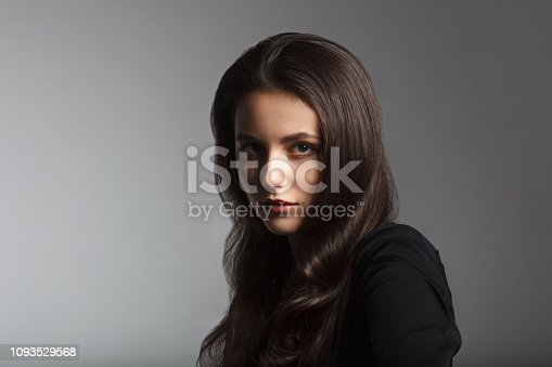 close up portrait of young brown hair woman