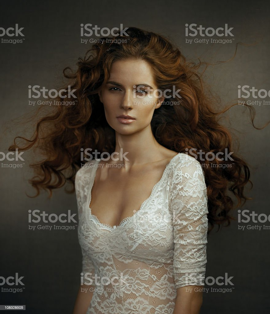 Studio portrait of beautiful young woman royalty-free stock photo