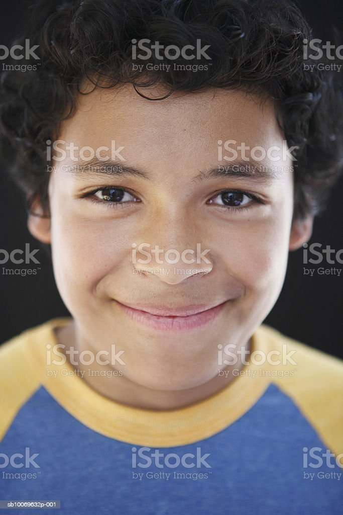 Studio portrait of boy (12-13) smiling, close-up royalty-free stock photo